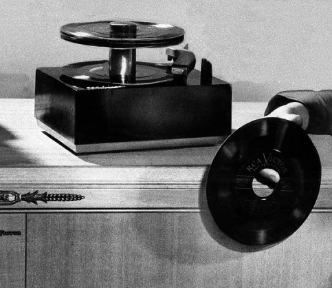 RCA Victor's new 45-RPM phonograph & records. Finest Quality reproduction at low cost in history of Industry credited to new system; first single disc size for all pops and classics. Undated photo. (AP Photo)
